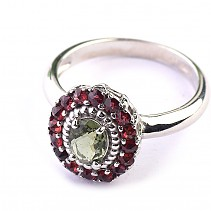 Moldavite oval ring with a garnet standard cut 925/1000 Ag + Rh